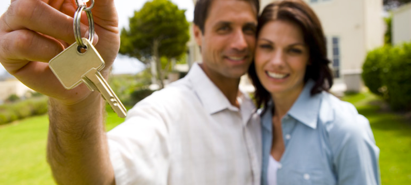 Man and woman with key to new home